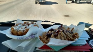 Lunch of champions: pulled pork fries and funnel cake.