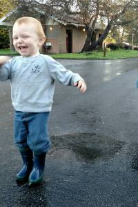 Happiness is running through a puddle.