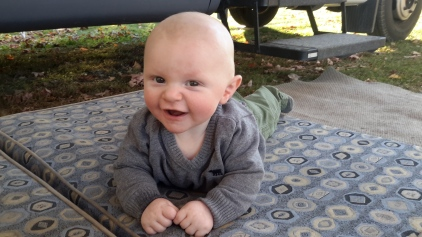 Alex enjoying some tummy time outside on the dinette cushions.