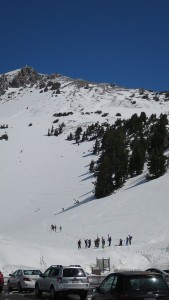 Ski and snowboarders at the Lassen trail head.